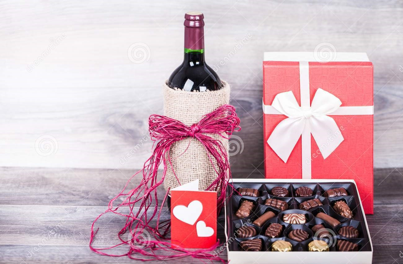 5774-wine-box-chocolates-red-bottle-love-message-gift-decoration-heart-wooden-table-valentines-day-celebration-108726309