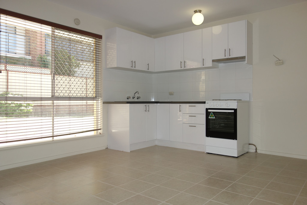 AIR CONDITIONED MODERN TWO BEDROOM UNIT!!!
