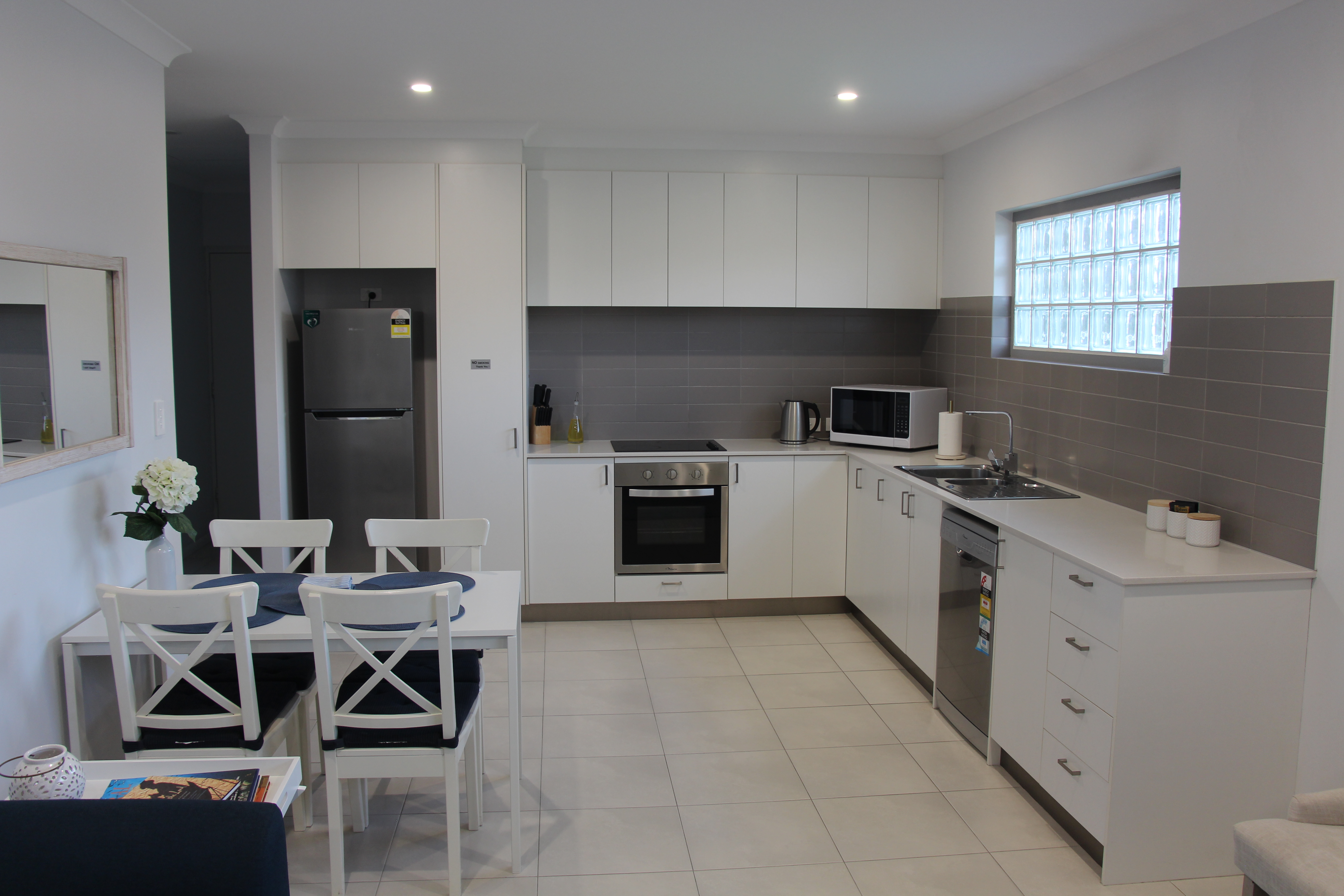 MODERN, NEAR NEW, DESIGNER FURNISHED APARTMENT WITH SPLIT SYSTEM HEATING!!!